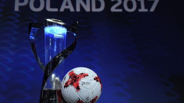 The UEFA Under-21 Championship trophy and adidas official match ball on the stage ahead of the UEFA European Under-21 Championship Final Tournament Draw