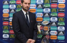 Poland coach Marcin Dorna with the UEFA European Under-21 Championship trophy at the UEFA European Under-21 Championship Final Tournament Draw